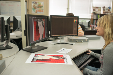 A student studying graphic design