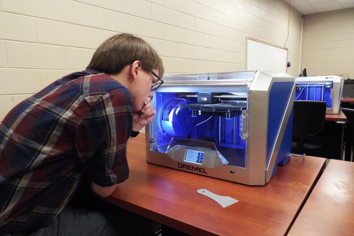 TCAT Elizabethton's Tyler Hankes works with 3D printer in computer lab