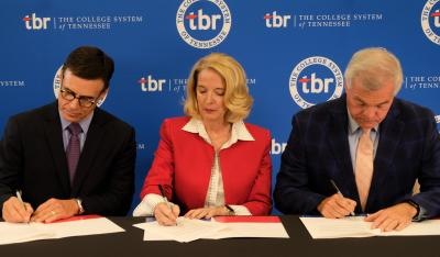 Chester Co. Schools Director Troy Kilzer, TBR Chancellor Flora W. Tydings, USDA Rural Development TN State Director Jim Tracy sign grant papers to assist workforce in Chester, Decatur, Henderson, Perry counties