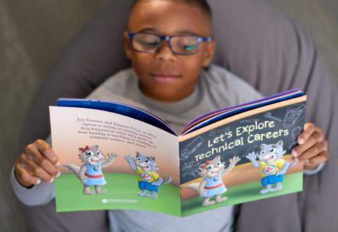 A young reader enjoys learning about technical careers in a new children's book from Tennessee's Colleges of Applied Technology.