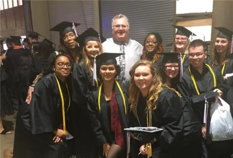 TCAT Nashville President Mark Lenz with graduates of the college