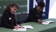 JSCC President Allana Hamilton and UofM Provost Karen Weddle-West sign MOU