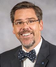 Dr. Tristan Denley headshot